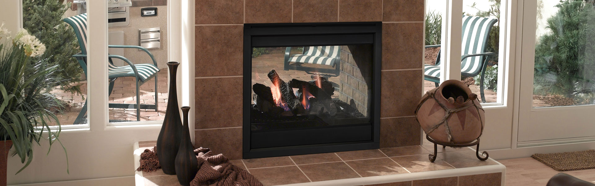 <p>Outdoor Lifestyles Twilight II Gas Fireplace shown with black basic interior front</p>